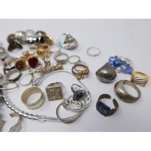 103 - A large collection of silver and costume jewellery rings, many gem-set with a Swarovski-crystal set ...