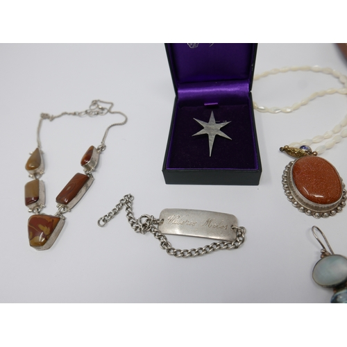 145 - A brown jewellery box containg items of sterling silver and gem set jewellery to include necklaces, ...