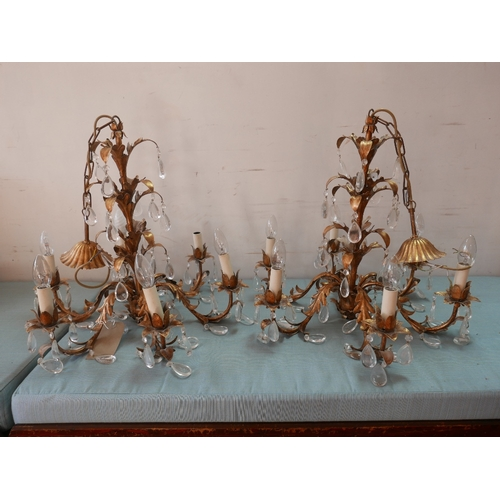 242 - A pair of gilt metal chandeliers with glass droplets...