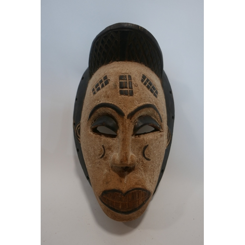 36 - An African Punu tribal mask, with white patina and scarification, H.40cm...