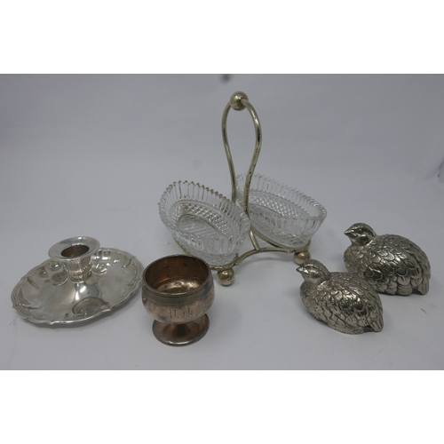 38 - A collection of silver plated ware, comprising candlestick, glass dishes on stand, two bird salt and...