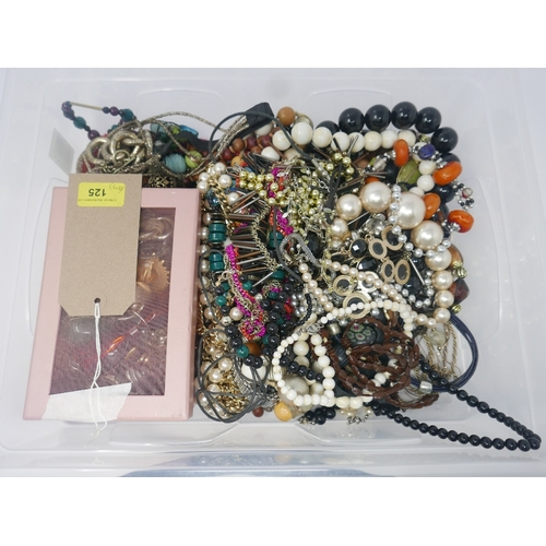 125 - A large quantity of costume jewellery to include many beaded necklaces and a pink box containing num...