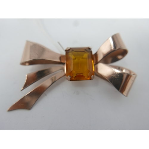 75 - A large vintage, sterling silver and rose gold plated bow brooch centrally set with a stepped-cut, o...