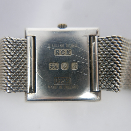 9 - A 1970's Roy King silver wristwatch, square textured dial signed, the textured silver bracelet with ...