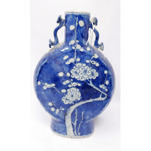 18 - A 19th century Chinese blue & white porcelain moon flask vase, with prunus design and four character...