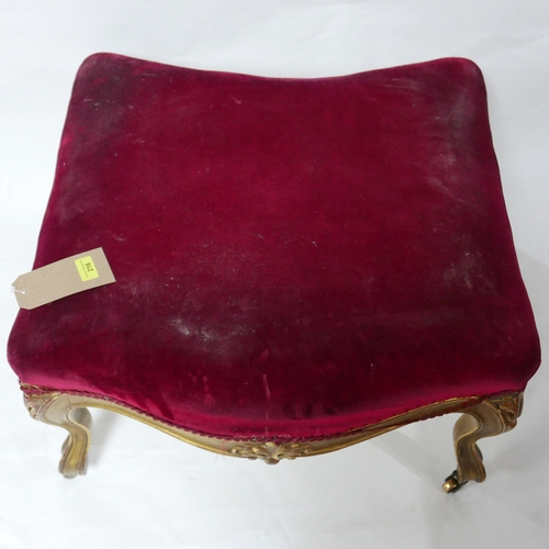 216 - A late 19th century gilt wood stool, pink velour upholstery, raised on cabriole legs and castors, H....