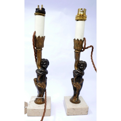 104 - A pair of 19th century bronze candlestick holders, later converted to electricity...