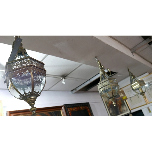 314 - A set of three gilt metal and glass hexagonal wall hanging storm lanterns...