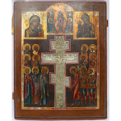 24 - A Russian icon with panels of the Mother of God above a central white metal crucifix, 44cm x 35cm...