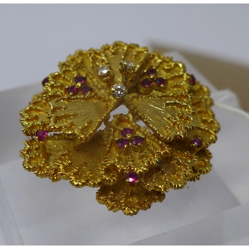 1005 - An 18ct yellow gold, flower-head brooch composed of eighteen gold petals studded with a total of thr...