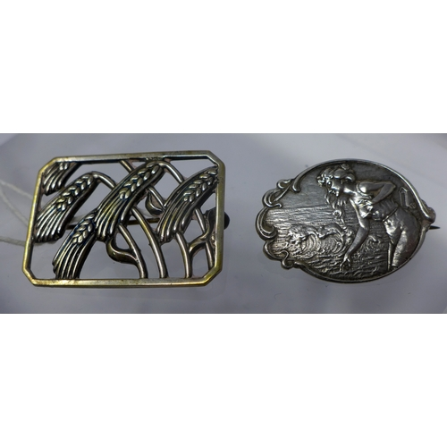 1223 - Two silver brooches to include an Art Nouveau oval-shaped example 2.3 x 3.3cm and a rectangular Art ...