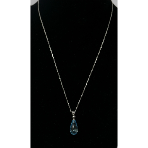1095 - A boxed 9ct white gold and faceted blue topaz drop pendant on 9ct white gold chain, L: 44cm, pendant...