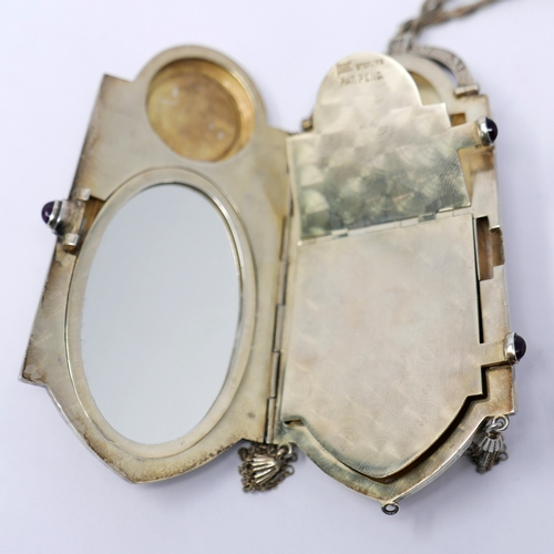 1025 - An Art Deco sterling silver and enamelled ladies compact, suspended from a silver ropetwist cord, al...