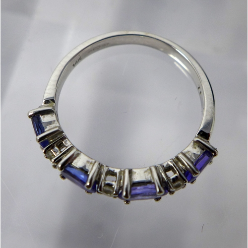 1131 - A 14 ct white gold, diamond and tanzanite ring, alternately set with three round briliant-cut diamon...
