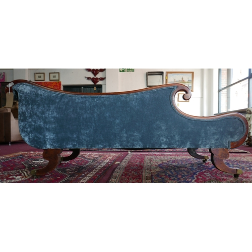 130 - A Regency inlaid mahogany chaise lounge, with blue velour upholstery, on scrolling supports, H.80 W....