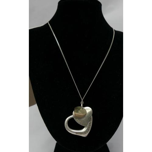 1221 - A Tiffany & Co sterling silver triple-heart pendant on sterling silver chain, L: 54cm, pendant: 3.5 ...