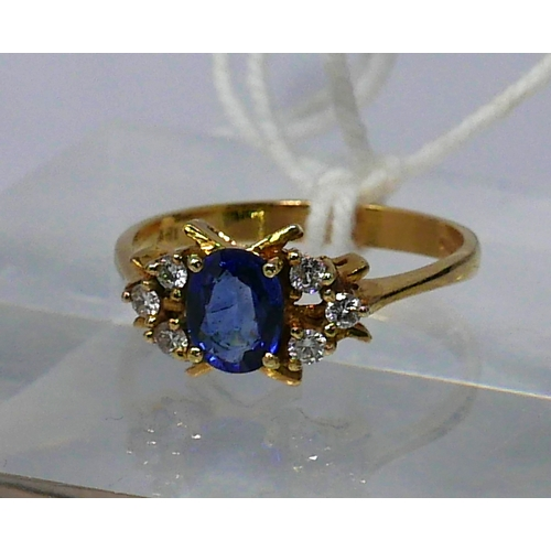 1022 - An 18ct yellow gold, natural Ceylon sapphire and diamond ring, the central, faceted oval, 'cornflowe...