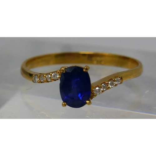 1140 - A 14ct yellow gold, diamond and Ceylon sapphire ring, centrally set with a round, natural, faceted s...