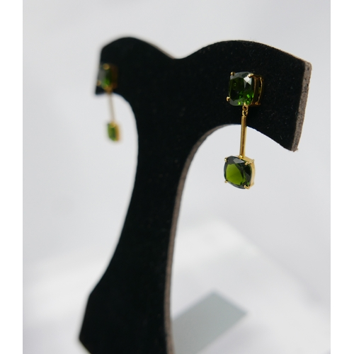 1282 - A pair of 14ct yellow gold and green garnet drop earrings, each earring composed of a cushion-shaped...