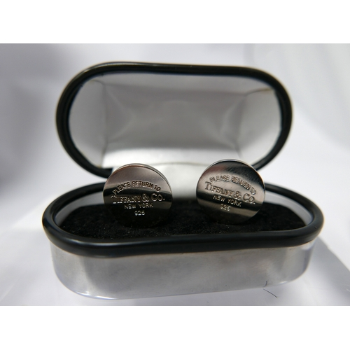 1226 - A pair of sterling silver, Tiffany & Co cufflinks, each composed of a circular panel stamped 'please...