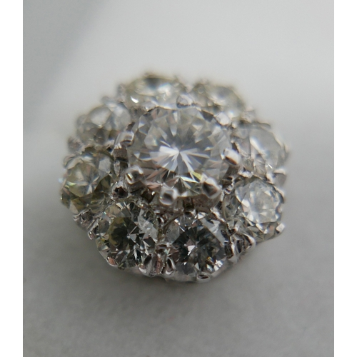 5 - A pair of platinum and 18ct white gold diamond cluster stud earrings (approx 2 carats total), each e...