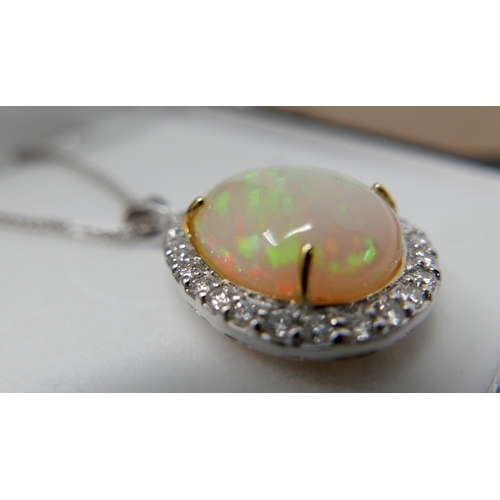 11 - A boxed 18ct white gold, diamond and pear-shaped opal pendant on an 18ct white gold chain, Pendant: ...