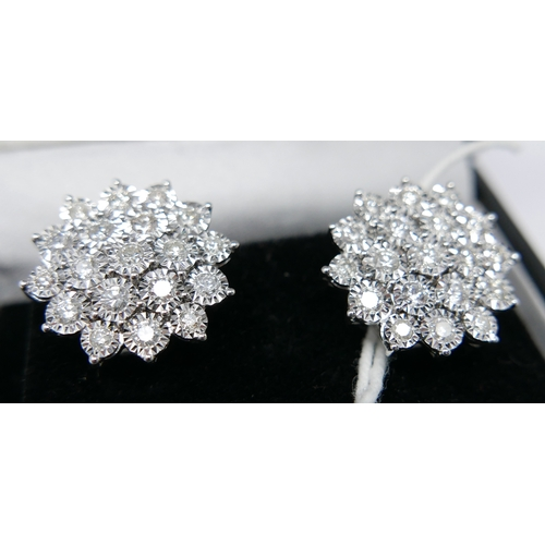 15 - A boxed pair of 18ct white gold, diamond cluster stud earrings (Total: 2 carats), each earring set w...