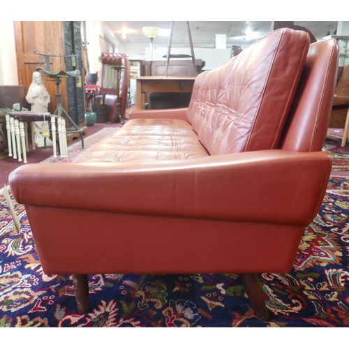 199 - A 20th century Danish four seater leather sofa, H.76 W.235 D.72cm...