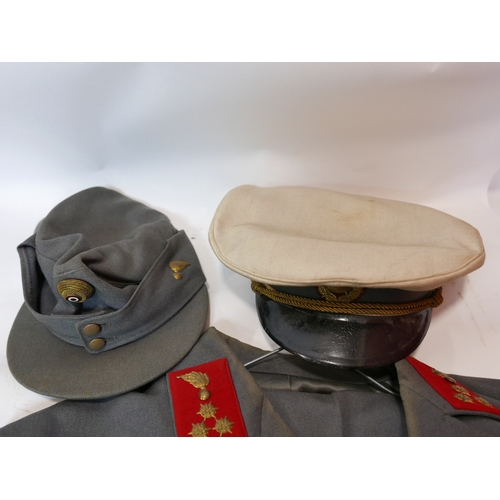129 - A vintage Austrian army uniform, comprising trousers, jacket and cap, together with an Austrian army...