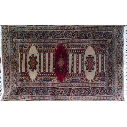 47 - A 20th century signed Afghan rug, triple geometric medallion, geometric borders, 102 x 62cm...