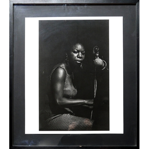48 - Francine Winham (1937-2013), a print of a photograph of Nina Simone, signed in pencil, 60 x 50cm...