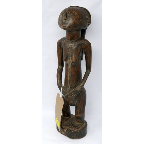 14 - An African carved wooden figure of a woman with scarification to face and body, H.43cm...