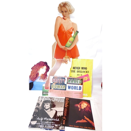 50 - A collection of cardboard cut out advertising and posters, to include Stella Artois, Kate Bush, a Gi...