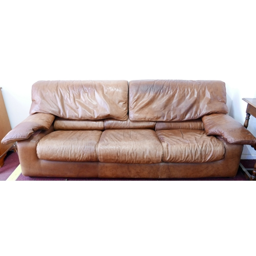 150 - A 1970's Roche Bobois brown leather three seat sofa...