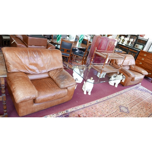 152 - A pair of 1970's Roche Bobois brown leather armchairs...