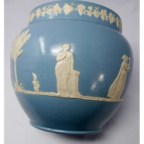 82 - A late 19th / early 20th century Dudson jasperware vase, continuously decorated with Classical figur...