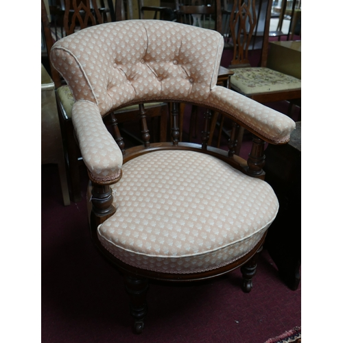 144 - A Victorian aesthetic mahogany tub chair on castors...