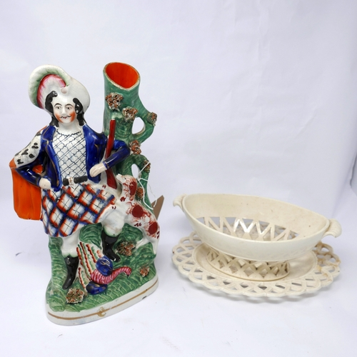 122 - A Victorian Staffordshire figure of a hunter together with a 19th century cream ware porcelain baske...