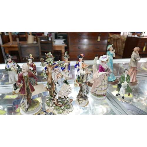 83 - A collection of ceramic figures to include 5 Capodimonte soldiers, Royal Doulton seated gentleman, 3...