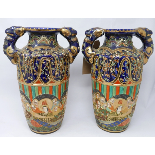 114 - A pair of early 20th century Japanese vases, H.34cm...
