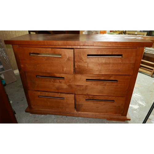56 - A 20th century teak chest of drawers, 100 x 148 x 50cm...