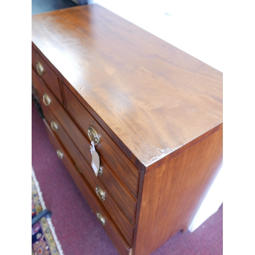 174 - A Georgian mahogany chest of two short over three long drawers, raised on outswept feet, H.105 W.103...