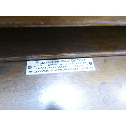 188 - A walnut bureau, with compartmentalised interior having plaque 'presented to JTW Peat 1936' above th...