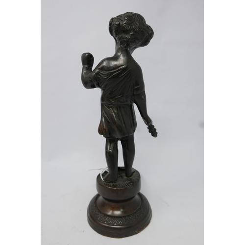137 - A bronze figure of a standing cherub on socle base. H.26cm...
