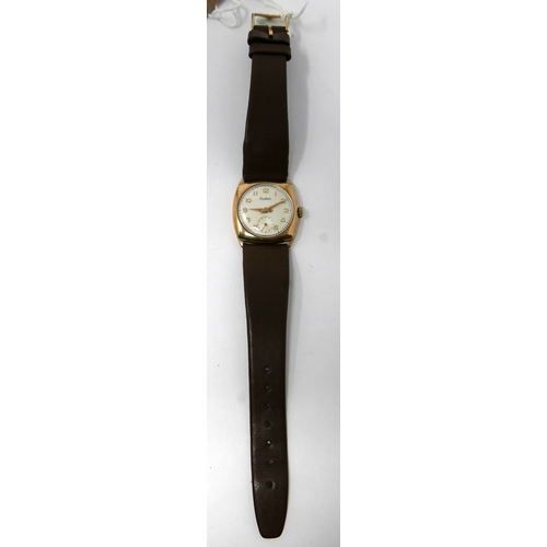 1091 - A 9ct yellow gold cased Audax wristwatch on a brown leather strap, the squared gold case containing ...