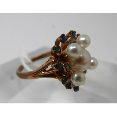 1063 - A 9ct yellow gold, sapphire pearl and diamond cluster ring, set with 12 outer sapphires, 8 diamonds ...