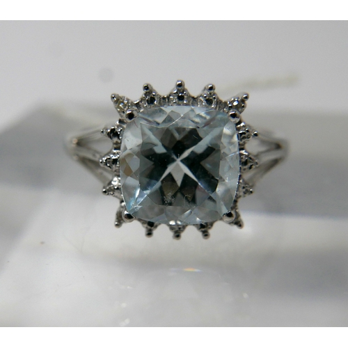 1150 - A 9ct white gold, diamond and aquamarine cluster ring, centrally set with a square, princess cut aqu...