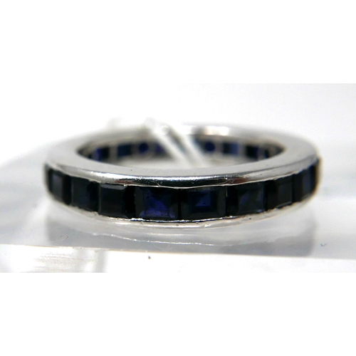 1029 - An 18ct white gold and callibre-cut sapphire ring composed of 24 natural sapphires in a channel-sett...