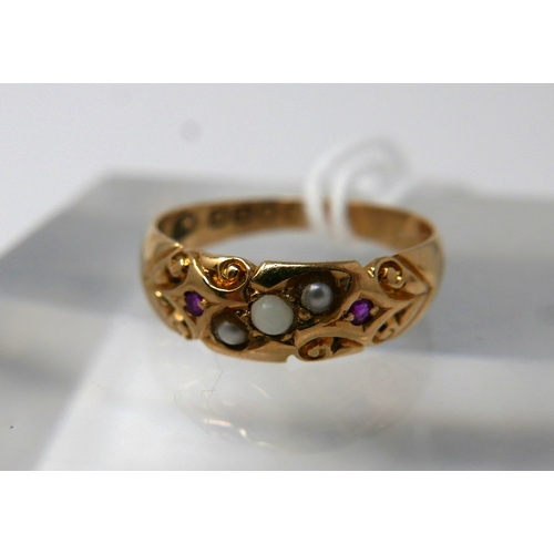 1058 - An 18ct yellow gold, Victorian, ruby and pearl ring with carved detailing, Size: J 1/2, 2.3g...