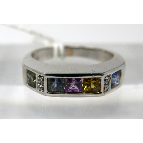1057 - An 18ct white gold, multi sapphire and diamond ring, channel set with 5 square, princess cut sapphir...